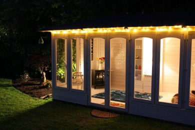 summer house in the garden lit at night