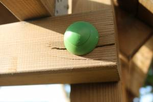 Splits On Timber Held With A Green Rounded Safety Cap