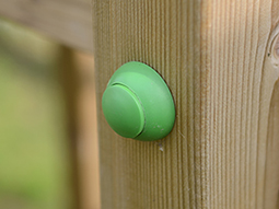 green round safety cap on climbing frame