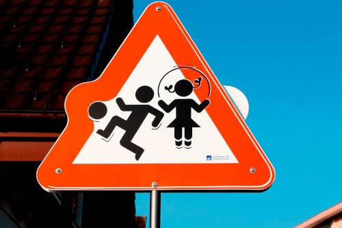 kids playing road sign red triangle sign