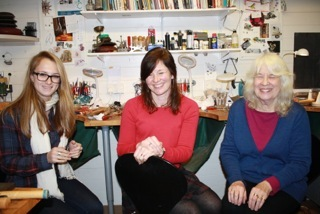 three women making jewellery