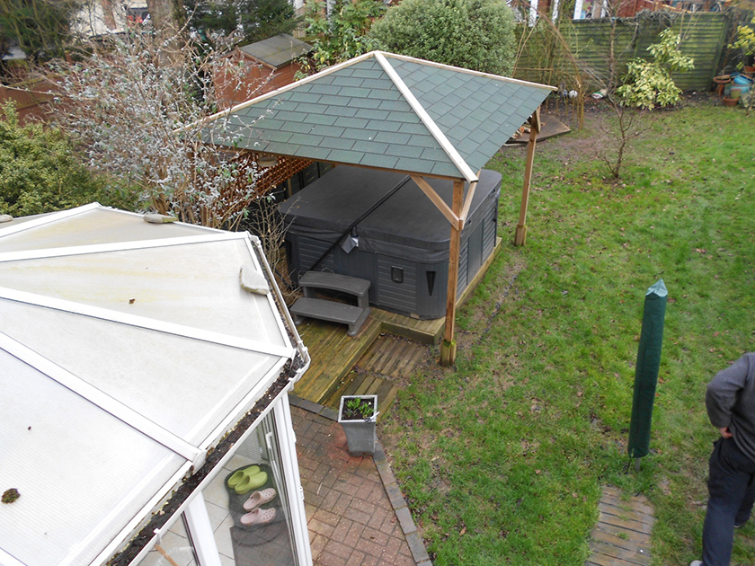 gazebo with hot tub in the garden