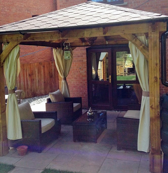 wooden gazebo with garden furniture