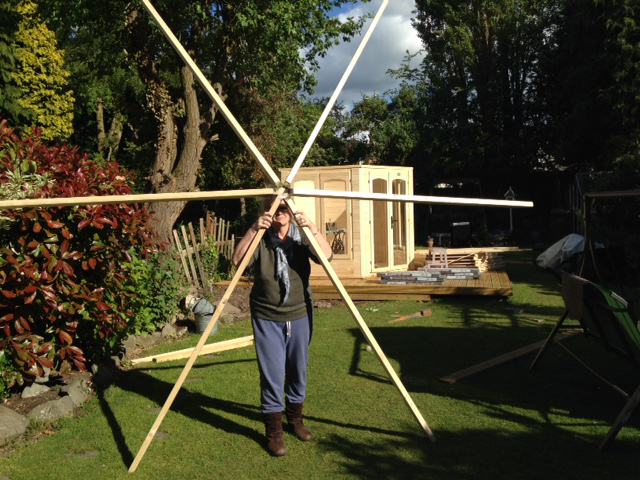 man holding summerhouse roof
